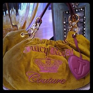 Genuine juicy couture velvet and leather purse.
